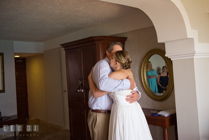 Bride hugging his Father one last time before walking down the isle. Cruise ship destination wedding ceremony photos, Hotel Melia Cozumel Mexico by photographers of Leo Dj Photography.
