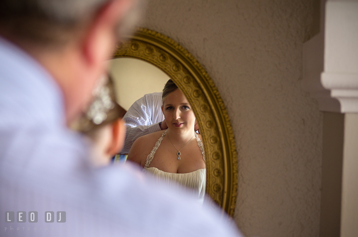 View from the mirror Father of the Bride helping daughter. Cruise ship destination wedding ceremony photos, Hotel Melia Cozumel Mexico by photographers of Leo Dj Photography.