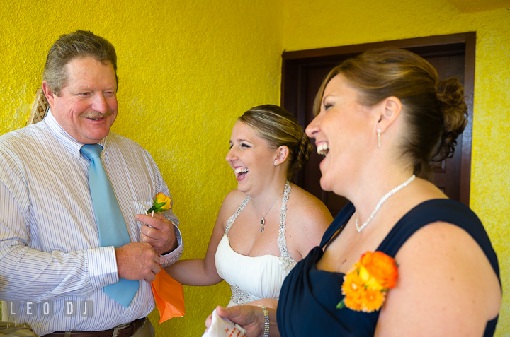 Father, mother, and bride laughing together. Cruise ship destination wedding ceremony photos, Hotel Melia Cozumel Mexico by photographers of Leo Dj Photography.