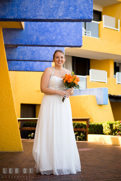Bride laughing waiting for Groom to come. Cruise ship destination wedding ceremony photos, Hotel Melia Cozumel Mexico by photographers of Leo Dj Photography.