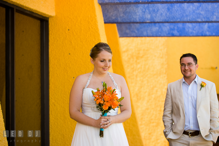 Bride sensed that Groom was coming during first glance. Cruise ship destination wedding ceremony photos, Hotel Melia Cozumel Mexico by photographers of Leo Dj Photography.