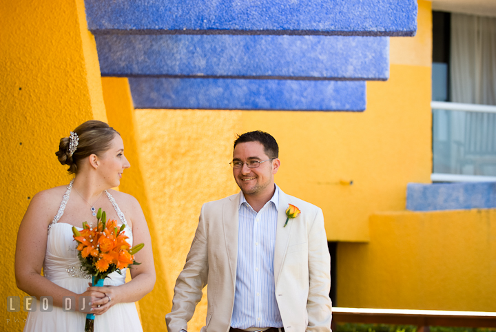 Bride's and Groom's eyes finally met during first glance. Cruise ship destination wedding ceremony photos, Hotel Melia Cozumel Mexico by photographers of Leo Dj Photography.