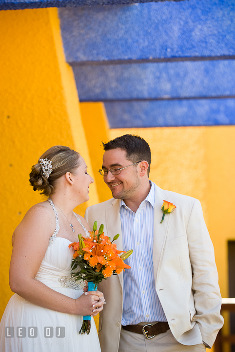Bride and Groom getting close during first glance. Cruise ship destination wedding ceremony photos, Hotel Melia Cozumel Mexico by photographers of Leo Dj Photography.