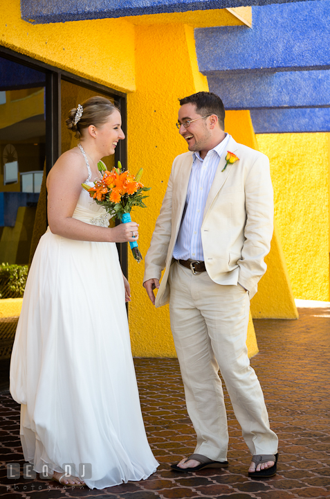 Bride and Groom laughing together after first glance. Cruise ship destination wedding ceremony photos, Hotel Melia Cozumel Mexico by photographers of Leo Dj Photography.