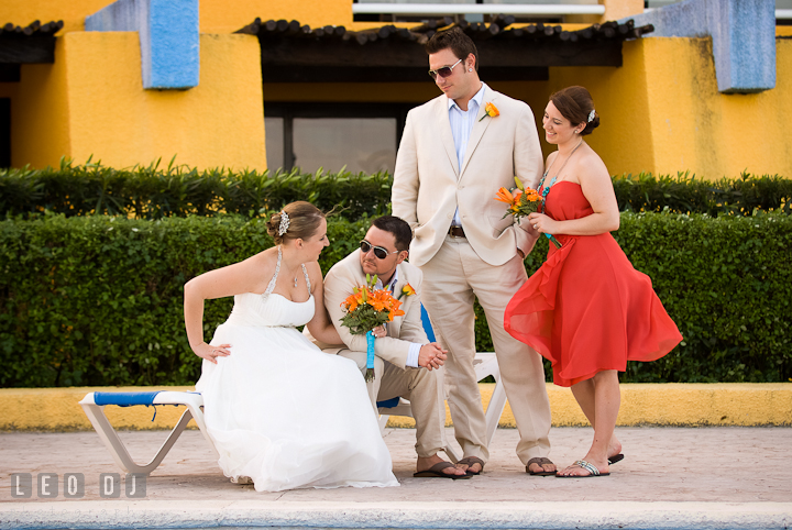 Bride, Groom, and wedding party posing together. Cruise ship destination wedding ceremony photos, Hotel Melia Cozumel Mexico by photographers of Leo Dj Photography.