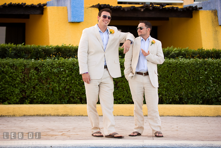 Best Man resting his arm on Groom's shoulder. Cruise ship destination wedding ceremony photos, Hotel Melia Cozumel Mexico by photographers of Leo Dj Photography.