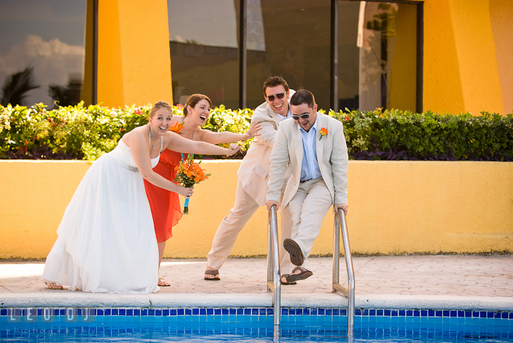 Bride and wedding party trying to stop Groom jumping in to the pool. Cruise ship destination wedding ceremony photos, Hotel Melia Cozumel Mexico by photographers of Leo Dj Photography.