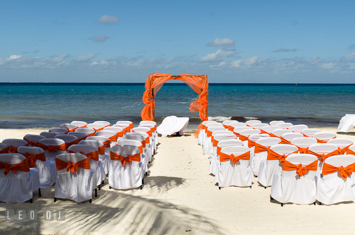 Ceremony location setting on the white sand beach, with clear blue water, and blue sky. Cruise ship destination wedding ceremony photos, Hotel Melia Cozumel Mexico by photographers of Leo Dj Photography.