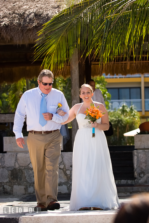 Father of the Bride escorting daughter walking down the isle. Cruise ship destination wedding ceremony photos, Hotel Melia Cozumel Mexico by photographers of Leo Dj Photography.