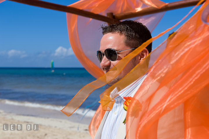 Groom smiling watching Bride walking down the isle. Cruise ship destination wedding ceremony photos, Hotel Melia Cozumel Mexico by photographers of Leo Dj Photography.