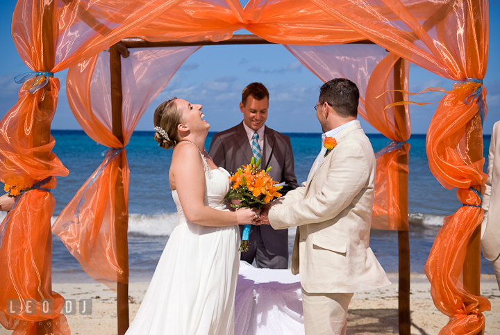 Bride and Groom laughing during the ceremony. Cruise ship destination wedding ceremony photos, Hotel Melia Cozumel Mexico by photographers of Leo Dj Photography.