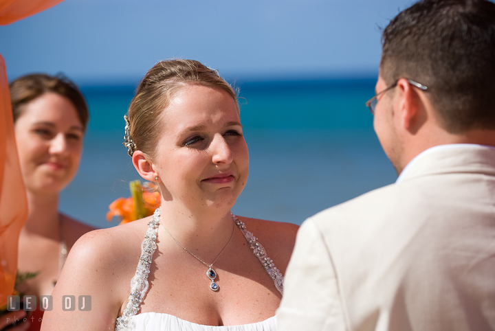 Bride gets emotional during vow recitation. Cruise ship destination wedding ceremony photos, Hotel Melia Cozumel Mexico by photographers of Leo Dj Photography.