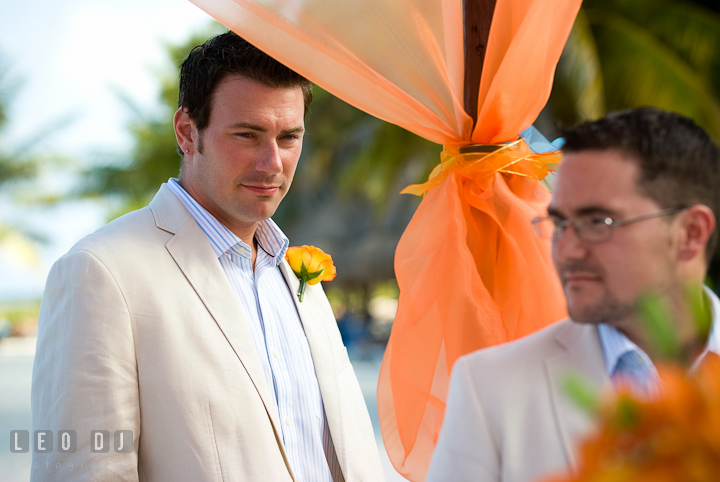 Best man looking at Groom. Cruise ship destination wedding ceremony photos, Hotel Melia Cozumel Mexico by photographers of Leo Dj Photography.