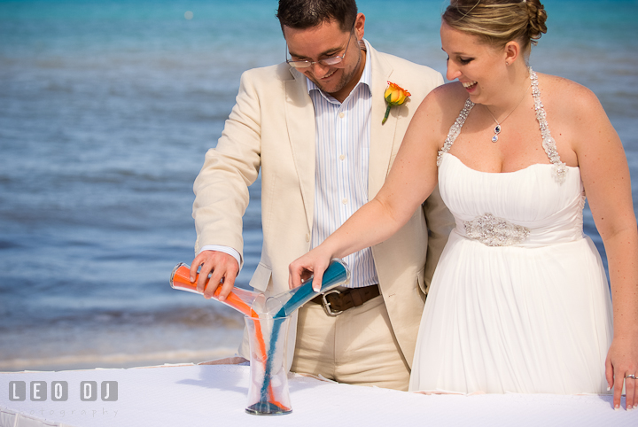 Bride and Groom pouring unity sand. Cruise ship destination wedding ceremony photos, Hotel Melia Cozumel Mexico by photographers of Leo Dj Photography.