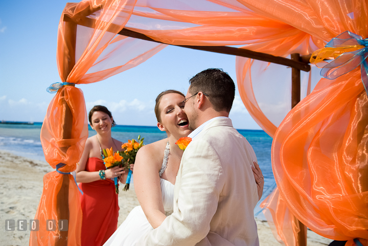 Bride and Groom officially husband and wife. Cruise ship destination wedding ceremony photos, Hotel Melia Cozumel Mexico by photographers of Leo Dj Photography.