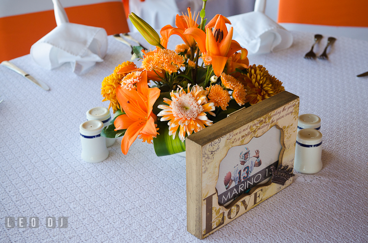 Table decoration number using football player jersey number. Carnival Cruise ship destination wedding reception photos of Jessica and Chad, Cozumel Mexico by photog