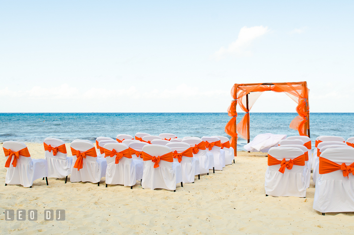 Wedding ceremony site on the beach with white sand and blue water. Carnival Cruise ship destination wedding reception photos of Jessica and Chad, Cozumel Mexico by photographers of Leo Dj Photography.