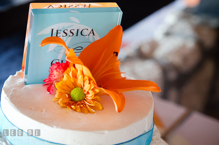 Flower decoration and wedding cake topping. Carnival Cruise ship destination wedding reception photos of Jessica and Chad, Cozumel Mexico by photographers of Leo Dj Photography.