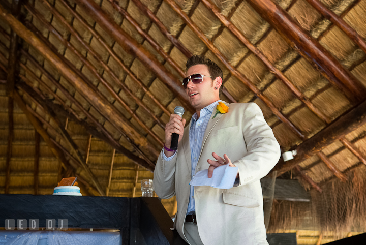 Best man delivering his speech. Carnival Cruise ship destination wedding reception photos of Jessica and Chad, Cozumel Mexico by photographers of Leo Dj Photography.