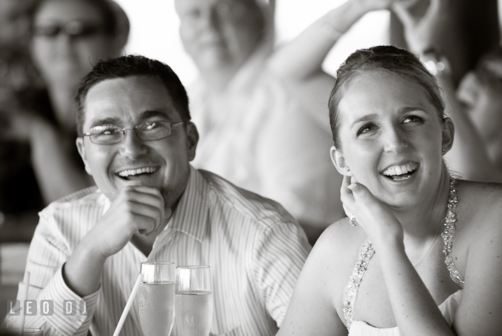 Bride and Groom laughing during speech. Carnival Cruise ship destination wedding reception photos of Jessica and Chad, Cozumel Mexico by photographers of Leo Dj Photography.