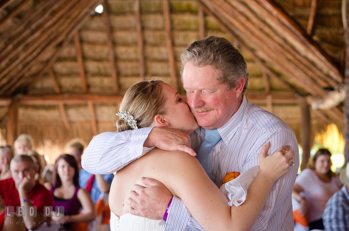Bride kissed Dad during Father Daughter dance. Carnival Cruise ship destination wedding reception photos of Jessica and Chad, Cozumel Mexico by photographers of Leo Dj Photography.