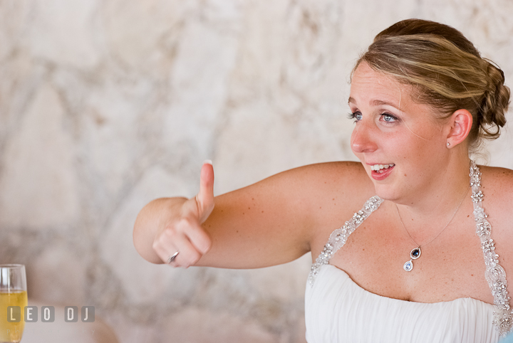 Bride gave thumbs up during Mother Son dance. Carnival Cruise ship destination wedding reception photos of Jessica and Chad, Cozumel Mexico by photographers of Leo Dj Photography.