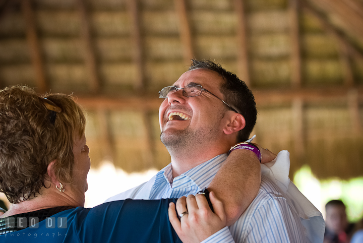 Groom laughed during Mother Son dance. Carnival Cruise ship destination wedding reception photos of Jessica and Chad, Cozumel Mexico by photographers of Leo Dj Photography.