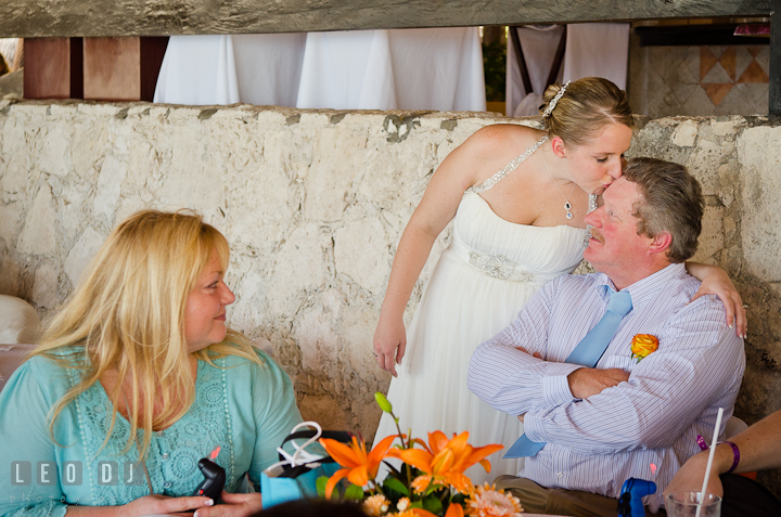Bride kissed Dad sitting by the table. Carnival Cruise ship destination wedding reception photos of Jessica and Chad, Cozumel Mexico by photographers of Leo Dj Photography.