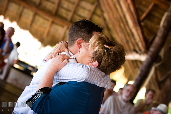 Groom hugged Mom during Mother Son dance. Carnival Cruise ship destination wedding reception photos of Jessica and Chad, Cozumel Mexico by photographers of Leo Dj Photography.