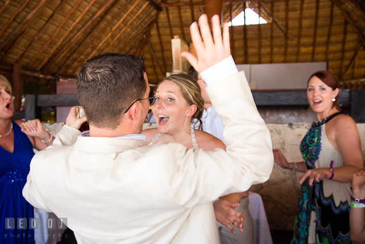 Bride, Groom and guests having fun dancing. Carnival Cruise ship destination wedding reception photos of Jessica and Chad, Cozumel Mexico by photographers of Leo Dj Photography.