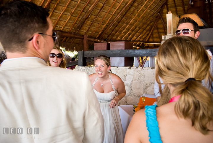 Bride laughing with Groom and guests during dancing. Carnival Cruise ship destination wedding reception photos of Jessica and Chad, Cozumel Mexico by photographers of Leo Dj Photography.