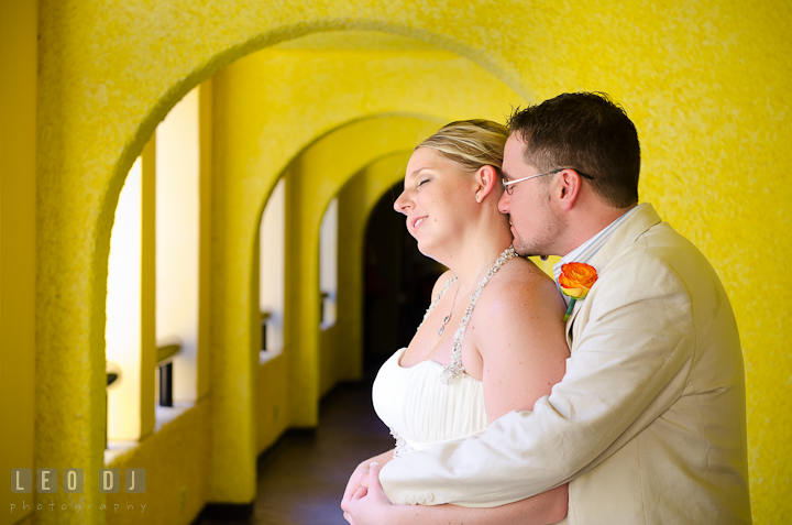 Bride and Groom cuddled in the hotel hallway. Carnival Cruise ship destination wedding reception photos of Jessica and Chad, Cozumel Mexico by photographers of Leo Dj Photography.