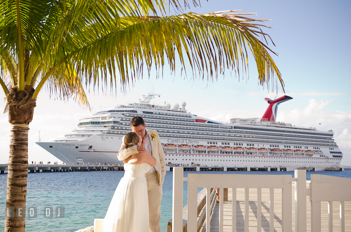 Bride and Groom kissing by where the cruise ship docked. Carnival Cruise ship destination wedding reception photos of Jessica and Chad, Cozumel Mexico by photographers of Leo Dj Photography.