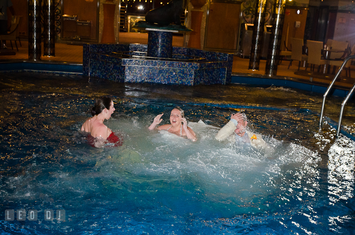 Bride, Groom and Maid of Honor popped up after jumped into the swimming pool to trash the dress. Carnival Cruise ship destination wedding reception photos, Cozumel Mexico by photographers of Leo Dj Photography.