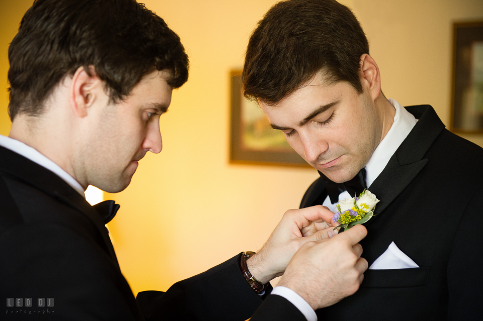 Kent Manor Inn wedding best man helping groom put boutonniere photo by Leo Dj Photography