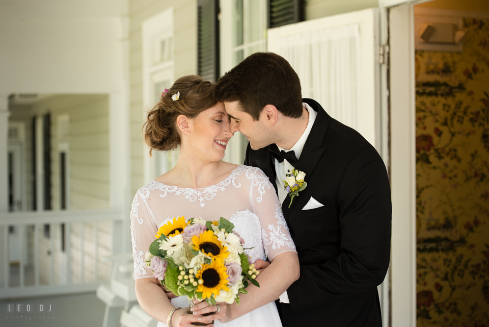 Kent Manor Inn wedding Bride and Groom cuddling by Leo Dj Photography