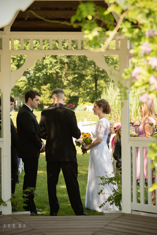 Kent Manor Inn Bride and Groom reciting vow during wedding ceremony photo by Leo Dj Photography