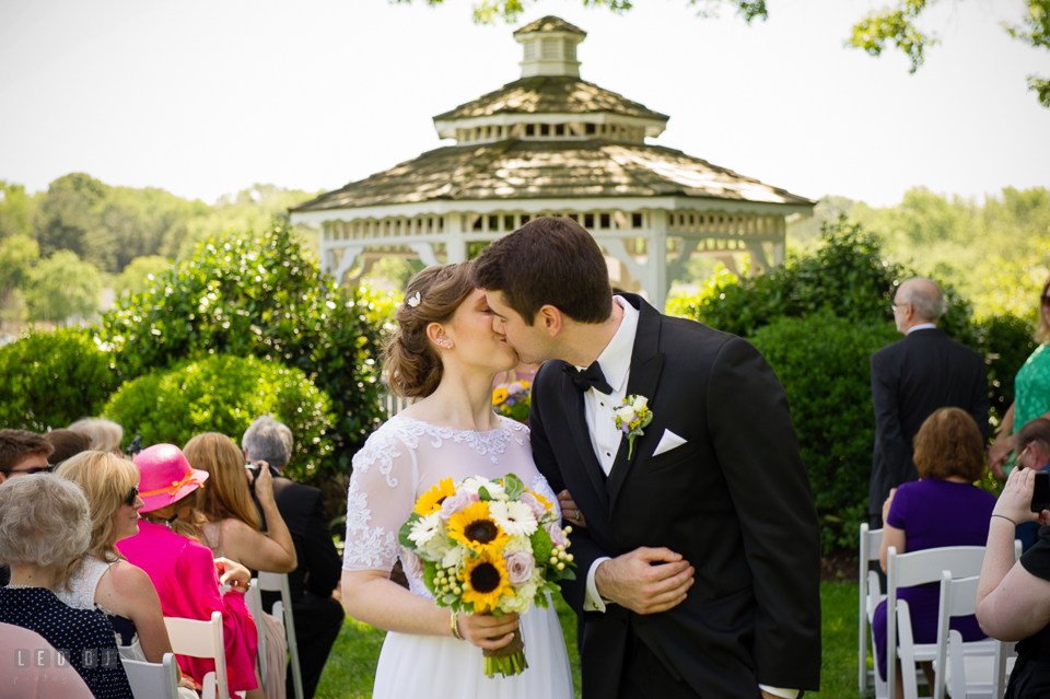 Kent Manor Inn Bride and Groom kissing during wedding ceremony processional photo by Leo Dj Photography