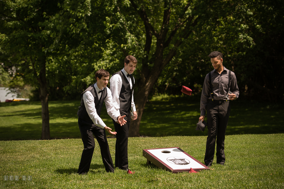 Eastern Shore Maryland Groom and guests playing corn hole photo by Leo Dj Photography