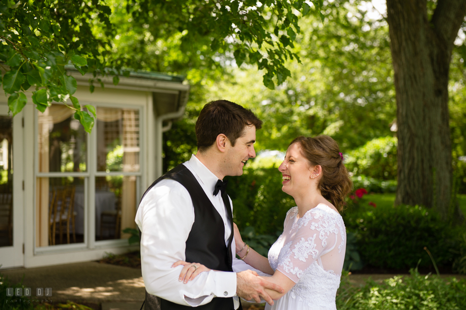 Kent Manor Inn wedding Groom laughing with Bride photo by Leo Dj Photography
