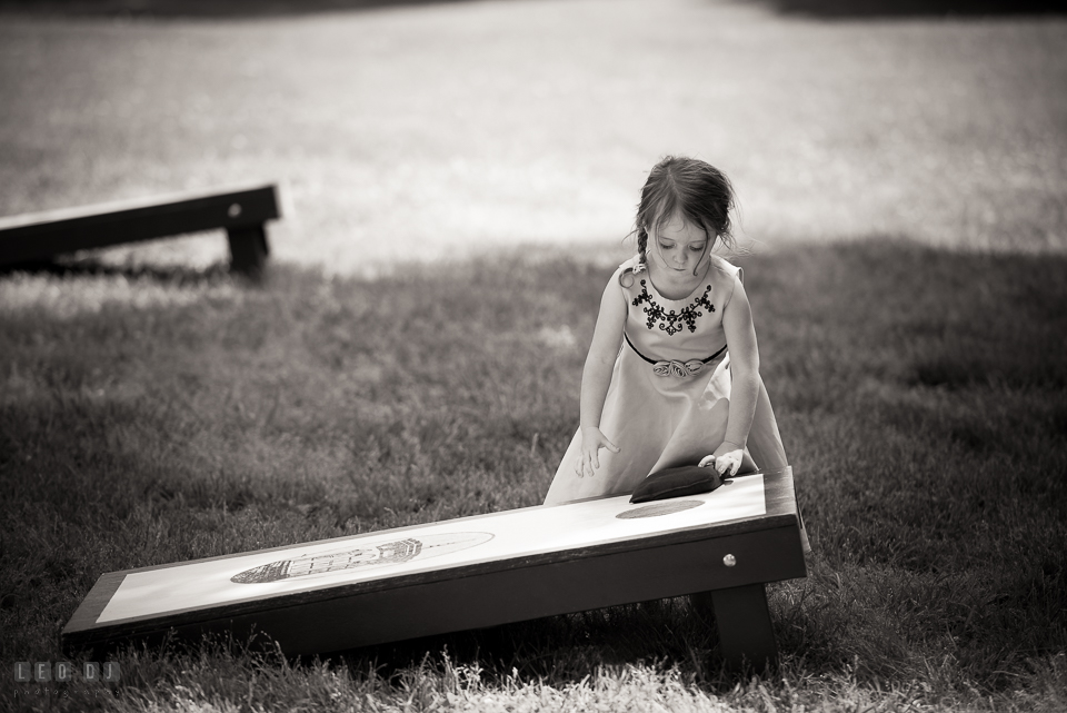 Kent Manor Inn wedding guest little girl playing corn hole photo by Leo Dj Photography