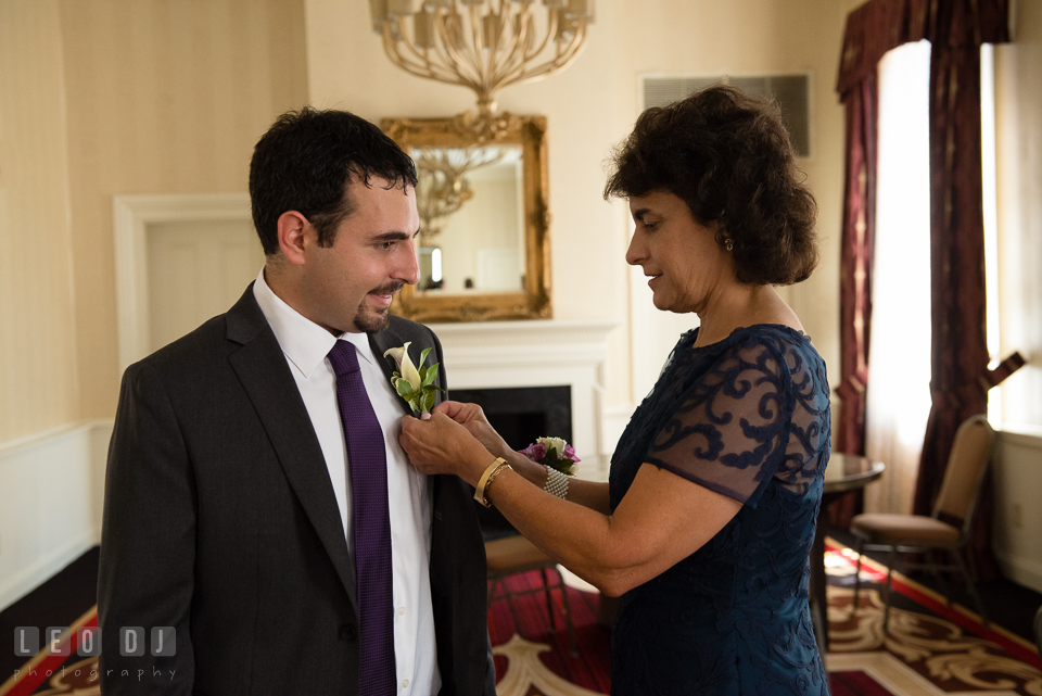 Mother of the Groom pinned the boutonniere on her son. Historic Inns of Annapolis Maryland, Governor Calvert House Greek wedding, by wedding photographers of Leo Dj Photography. http://leodjphoto.com