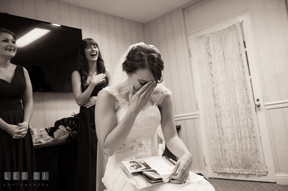 Bride's expression upon opening present from the Groom. Historic Inns of Annapolis Maryland, Governor Calvert House Greek wedding, by wedding photographers of Leo Dj Photography. http://leodjphoto.com