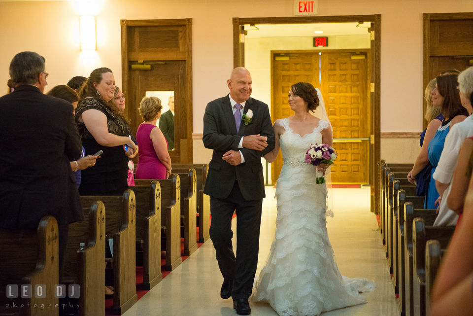 Bride walked down the aisle during procession escorted by her Father. Saints Constantine and Helen Greek Orthodox Church wedding, by wedding photographers of Leo Dj Photography. http://leodjphoto.com