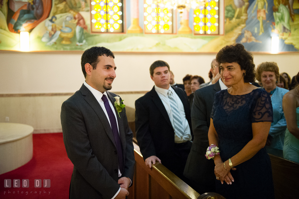 Groom happy seeing the Bride for the first time, while Mother shed tear proud of her son. Saints Constantine and Helen Greek Orthodox Church wedding, by wedding photographers of Leo Dj Photography. http://leodjphoto.com