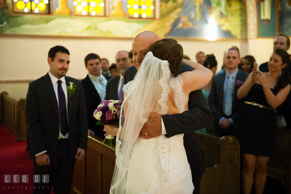Father of the Bride hugged her daugther giving her away to Groom. Saints Constantine and Helen Greek Orthodox Church wedding, by wedding photographers of Leo Dj Photography. http://leodjphoto.com