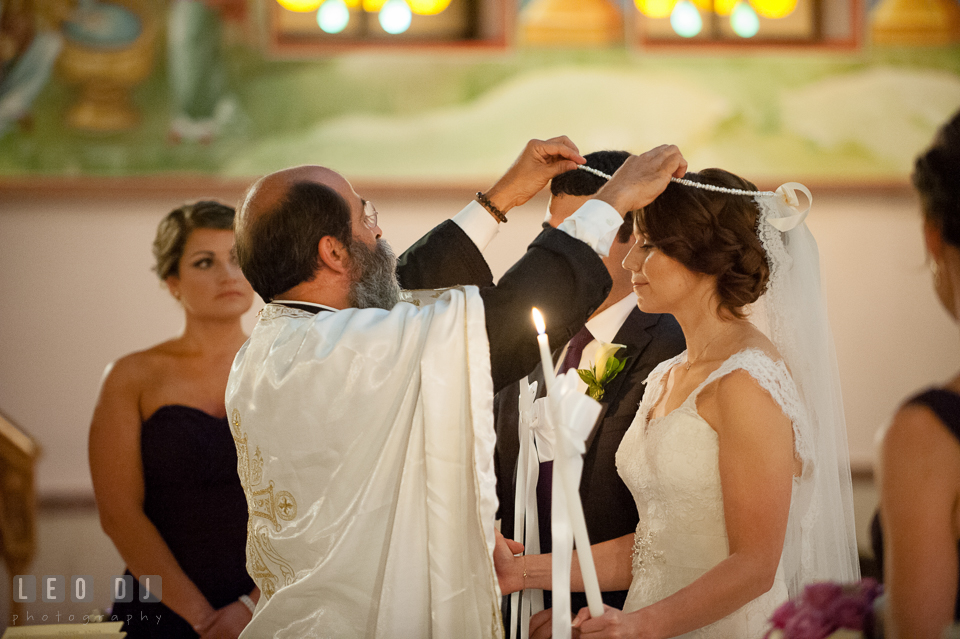 The crowning ceremony. Saints Constantine and Helen Greek Orthodox Church wedding, by wedding photographers of Leo Dj Photography. http://leodjphoto.com