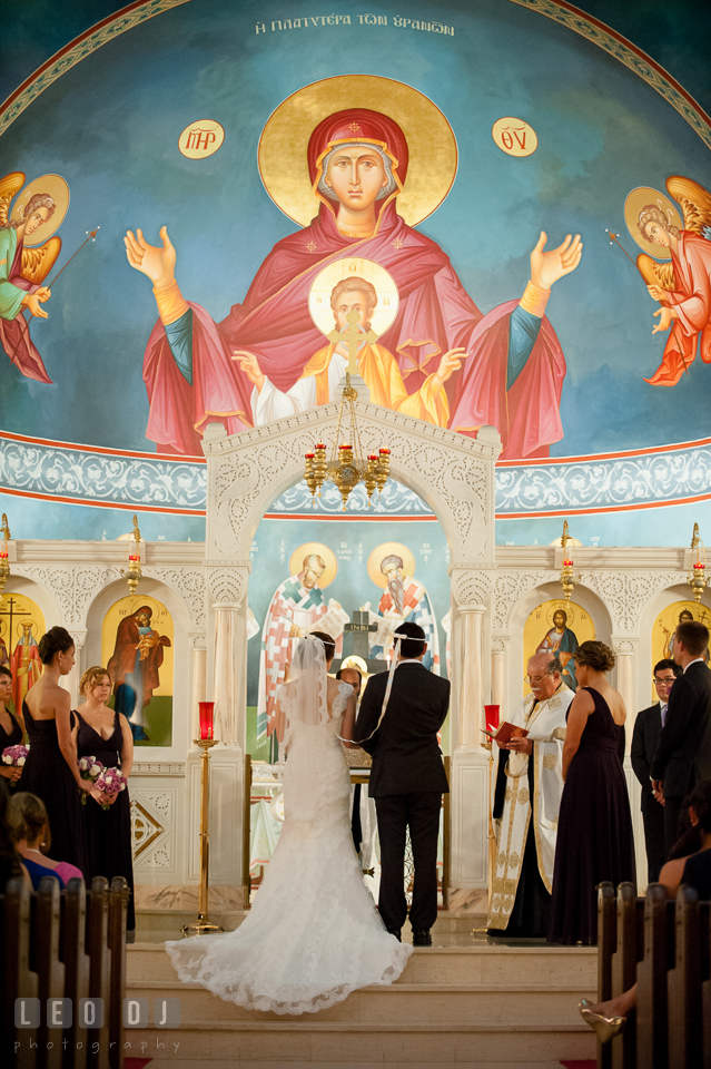 Bride and Groom in front of the church altar. Saints Constantine and Helen Greek Orthodox Church wedding, by wedding photographers of Leo Dj Photography. http://leodjphoto.com