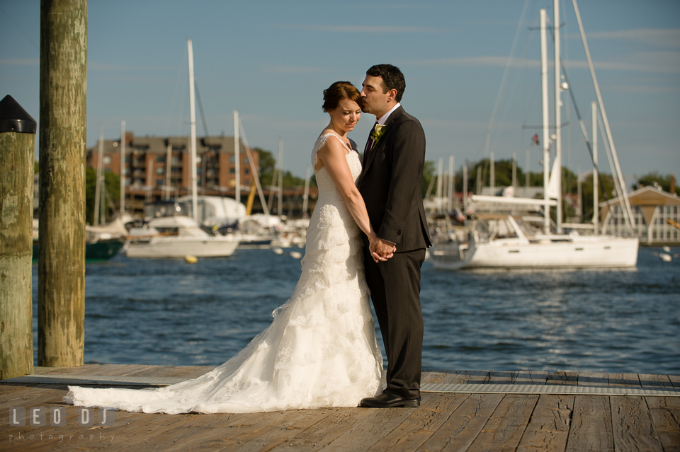 Bride and Groom taking pictures by the Annapolis downtown dock. Historic Inns of Annapolis Maryland, Governor Calvert House Greek wedding, by wedding photographers of Leo Dj Photography. http://leodjphoto.com