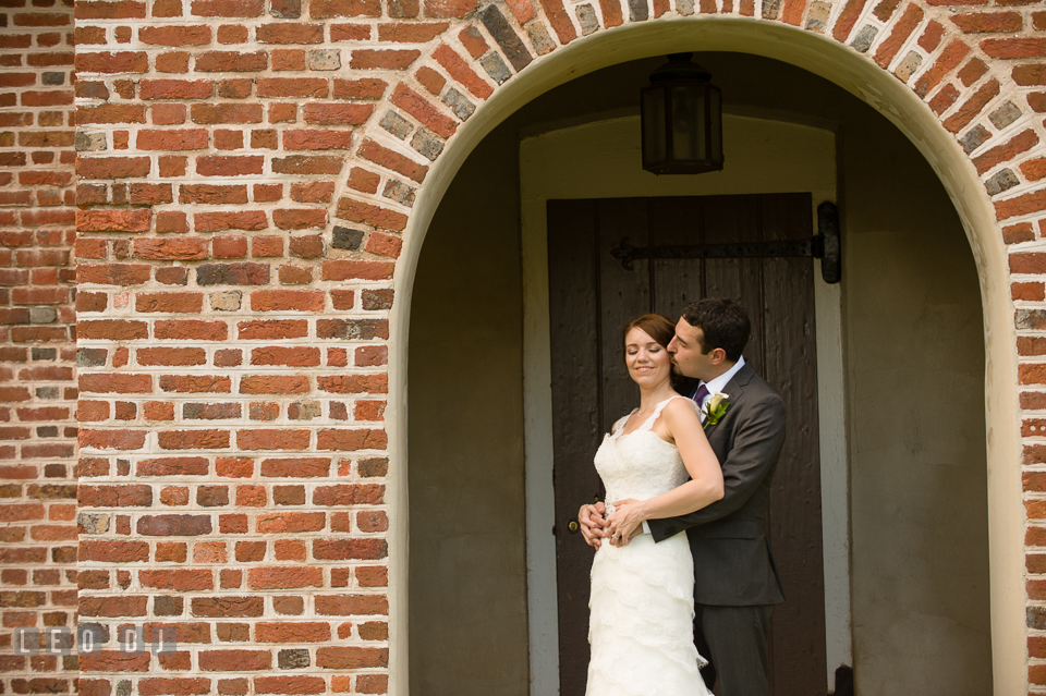 Groom kissing Bride. Historic Inns of Annapolis Maryland, Governor Calvert House Greek wedding, by wedding photographers of Leo Dj Photography. http://leodjphoto.com